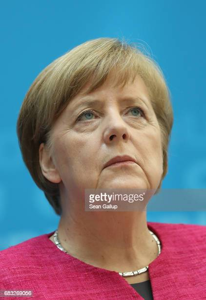 German Chancellor and Chairwoman of the German Christian Democrats Angela Merkel speaks to the media under a bannerr that reads 'The Middle' the day...