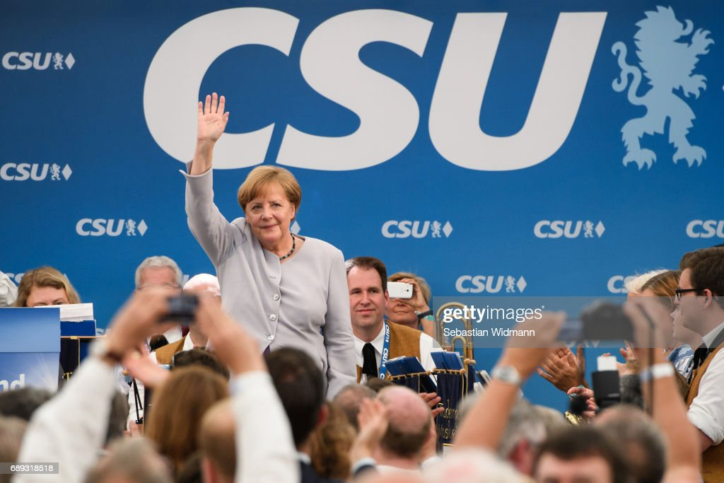 German Chancellor and Chairwoman of the German Christian Democrats (CDU) Angela Merkel waves to supporters after her speech at the Trudering fest on May 28, 2017 in Munich, Germany. The CDU and CSU, along with the German Social Democrats (SPD), form the current German coalition government, though relations between Merkel and Seehofer have been complicated as the two have clashed over certain issues, especially immigration.