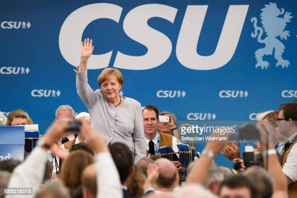 German Chancellor and Chairwoman of the German Christian Democrats Angela Merkel waves to supporters after her speech at the Trudering fest on May 28...