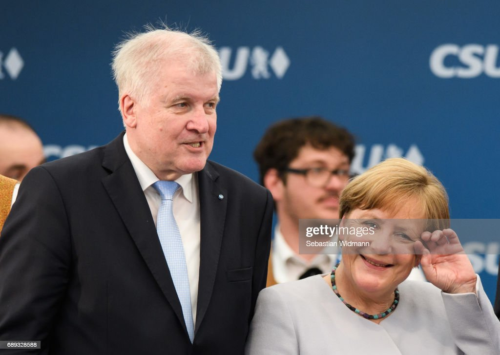 German Chancellor and Chairwoman of the German Christian Democrats (CDU) Angela Merkel and Bavarian Governor and Chairman of the Bavarian Christian Democrats (CSU) Horst Seehofer meet at the Trudering fest on May 28, 2017 in Munich, Germany. The CDU and CSU, along with the German Social Democrats (SPD), form the current German coalition government, though relations between Merkel and Seehofer have been complicated as the two have clashed over certain issues, especially immigration.