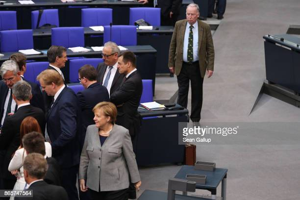 German Chancellor and Christian Democrat Angela Merkel and Alexander Gauland of the rightwing Alternative for Germany attend the opening session of...
