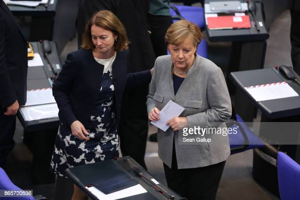 German Chancellor and Christian Democrat Angela Merkel and German Social Democrat Katarina Barley attend the opening session of the new Bundestag on...