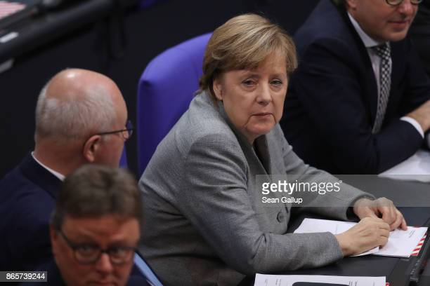 German Chancellor and Christian Democrat Angela Merkel attends the opening session of the new Bundestag on October 24 2017 in Berlin Germany Today's...