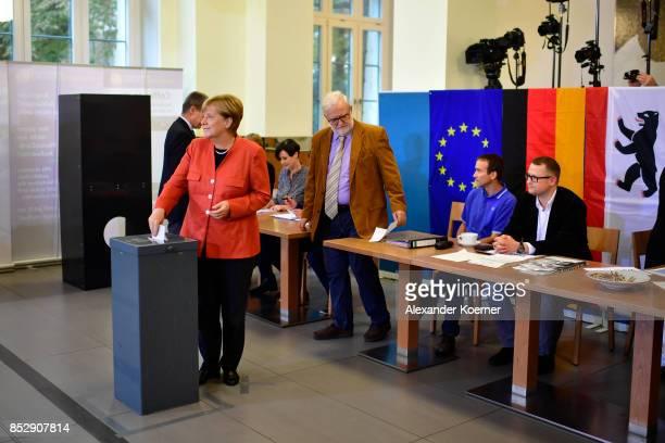 German Chancellor and Christian Democrat Angela Merkel casts her ballot in German federal elections on September 24 2017 in Berlin Germany Merkel is...