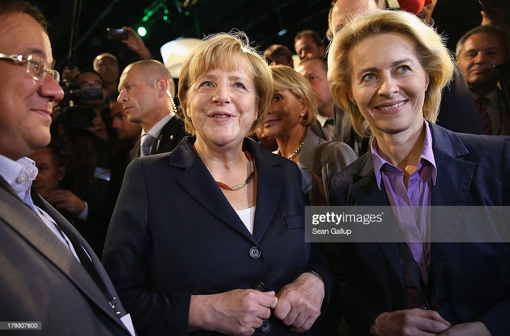 German Chancellor and Christian Democrat (CDU) <a gi-track='captionPersonalityLinkClicked' href=/galleries/search?phrase=Angela+Merkel&family=editorial&specificpeople=202161 ng-click='$event.stopPropagation()'>Angela Merkel</a> (C) chats with journalists and other visitors, including Minister of Work and Social Issues <a gi-track='captionPersonalityLinkClicked' href=/galleries/search?phrase=Ursula+von+der+Leyen&family=editorial&specificpeople=4249207 ng-click='$event.stopPropagation()'>Ursula von der Leyen</a> (R), moments after the conclusion of her live television debate with Social Democrats (SPD) chancellor candidate Peer Steinbrueck at the Adlershof studios on September 1, 2013 in Berlin, Germany. Today's live debate is the only one between the two candidates ahead of German elections scheduled for September 22.