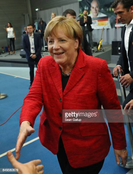 German Chancellor and Christian Democrat Angela Merkel greets supporters after she spoke at an election campaign stop on September 19 2017 in...