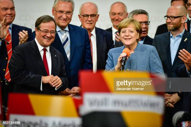 German Chancellor and Christian Democrat Angela Merkel Joachim Herrmann Armin Laschet and other members of CDU react to initial results that give the...