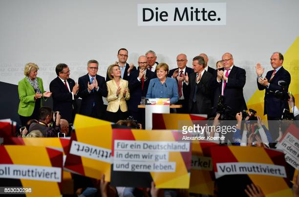 German Chancellor and Christian Democrat Angela Merkel reacts to initial results that give the party 329% of the vote giving it a first place finish...