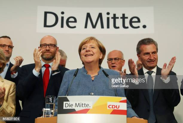 German Chancellor and Christian Democrat Angela Merkel speaks after initial results gave the party 329% of the vote giving it a first place finish in...