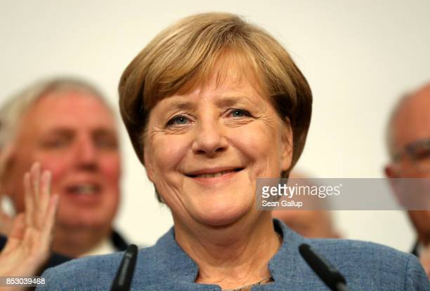 German Chancellor and Christian Democrat Angela Merkel speaks after initial results gave the party 331% of the vote giving it a first place finish in...