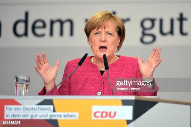 German Chancellor and Christian Democrat Angela Merkel speaks at a CDU election campaign stop on September 22 2017 in Heppenheim Germany Germans will...