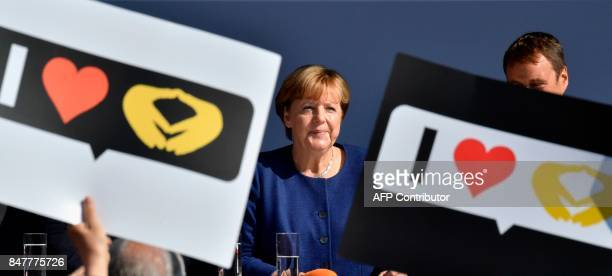 German Chancellor and Christian Democratic Union's main candidate Angela Merkel addresses supporters during an election rally at her constituency's...