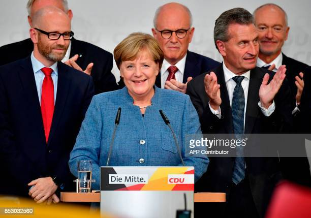 German Chancellor and Christian Democrats party leader Angela Merkel speaks on stage surrounded CDU Secretary General Peter Tauber and German EU...