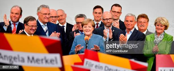 German Chancellor and Christian Democrats party leader Angela Merkel is back on stage after attending a television debate during the election night...