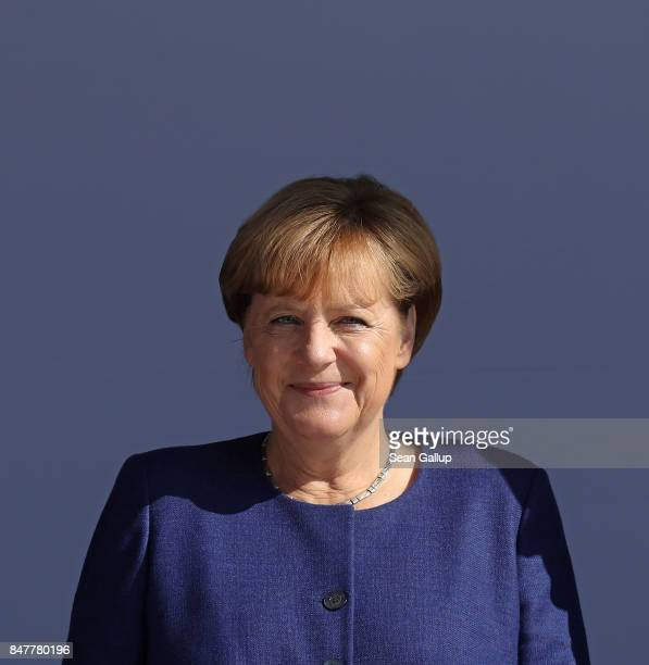 German Chancellor and Chrstian Democrat Angela Merkel smiles after speaking at an election campaign stop on the island of Ruegen on September 16 2017...
