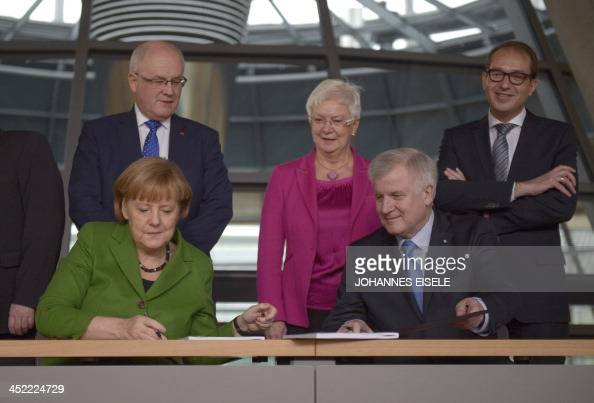 German Chancellor and head of Christian Democratic Party Angela Merkel and leader of CDU Bavarian allies Christian Social Union Horst Seehofer sign...
