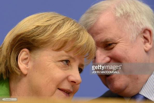 German Chancellor and head of Christian Democratic Party Angela Merkel and leader of CDU Bavarian allies Christian Social Union Horst Seehofer talk...