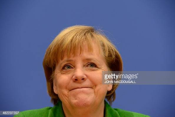 German Chancellor and head of Christian Democratic Party Angela Merkel is pictured at a press conference after signing an agreement with Bavarian...