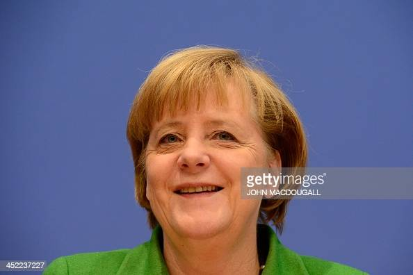 German Chancellor and head of Christian Democratic Party Angela Merkel is pictured at a press conference after signing an agreement to form a...