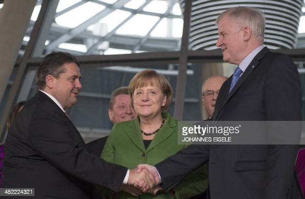 German Chancellor and head of Christian Democratic Party Angela Merkel stand between leader of CDU Bavarian allies Christian Social Union Horst...