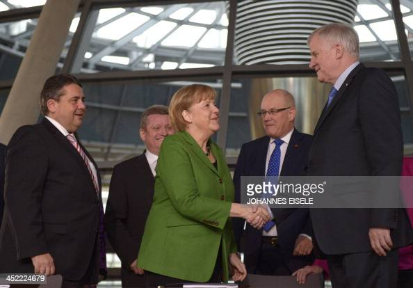 German Chancellor and head of Christian Democratic Party Angela Merkel shakes hands with CDU Bavarian allies Christian Social Union Horst Seehofer...