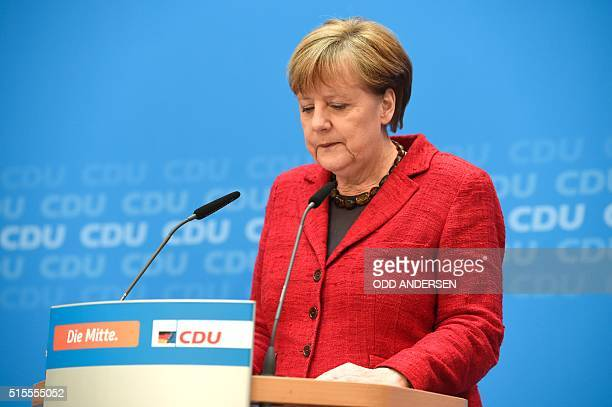 German Chancellor and head of the Christian Democratic Union Angela Merkel gives a press conference at CDU's headquarters in Berlin on March 14 2016...