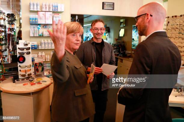 German Chancellor and head of the Christian Democrats party Angela Merkel and CDU Secretary General Peter Tauber visit some shops in Berlin Mitte...