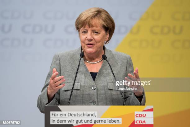 German Chancellor and head of the German Christian Democrats Angela Merkel speaks at the CDU federal election campaign opening rally on August 12...