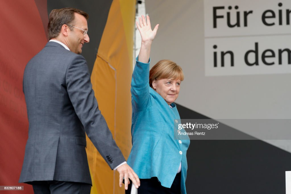 German Chancellor and head of the German Christian Democrats (CDU) Angela Merkel greets supporters upon her arrival for an election rally at the headland known as the 'Deutsches Eck' ('German Corner'), where the Mosel and Rhine rivers meet, on August 16, 2017 in Koblenz, Germany. Germany is scheduled to hold federal elections on September 24 and Merkel, who is running for a fourth term as chancellor, currently holds a double-digit lead over Martin Schulz from the German Social Democrats (SPD), her main opponent.