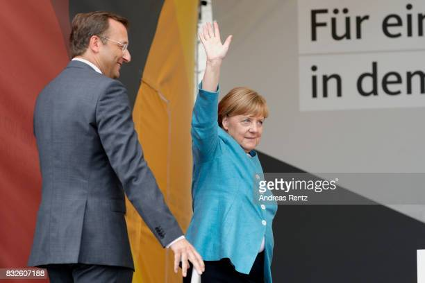 German Chancellor and head of the German Christian Democrats Angela Merkel greets supporters upon her arrival for an election rally at the headland...