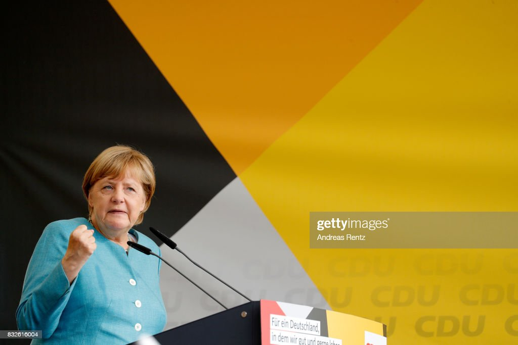 German Chancellor and head of the German Christian Democrats (CDU) Angela Merkel speaks on stage at an election rally at the headland known as the 'Deutsches Eck' ('German Corner'), where the Mosel and Rhine rivers meet, on August 16, 2017 in Koblenz, Germany. Germany is scheduled to hold federal elections on September 24 and Merkel, who is running for a fourth term as chancellor, currently holds a double-digit lead over Martin Schulz from the German Social Democrats (SPD), her main opponent.