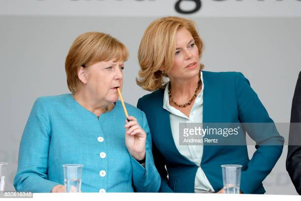 German Chancellor and head of the German Christian Democrats Angela Merkel and Chairman of CDU RheinlandPfalz Julia Kloeckner are seen on stage...