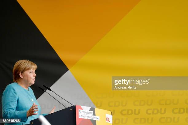 German Chancellor and head of the German Christian Democrats Angela Merkel speaks on stage at an election rally at the headland known as the...