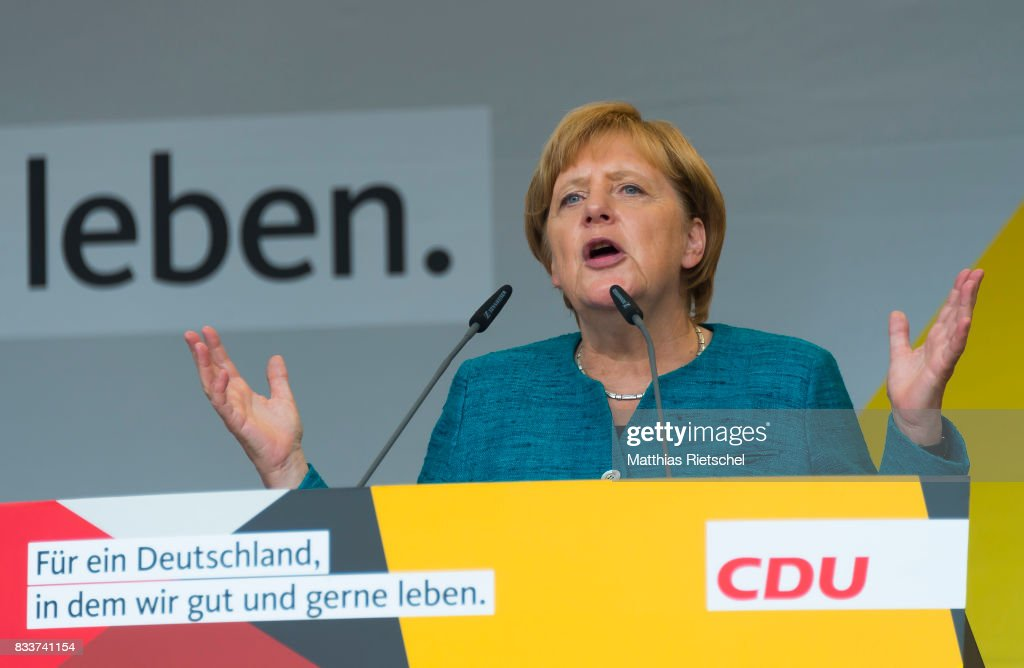 German Chancellor and head of the German Christian Democrats (CDU) Angela Merkel delievers a speech during an election rally in the state of Saxony on August 17, 2017 in Annaberg-Buchholtz, Germany. Germany is scheduled to hold federal elections on September 24 and Merkel, who is running for a fourth term as chancellor, currently holds a double-digit lead over Martin Schulz from the German Social Democrats (SPD), her main opponent.