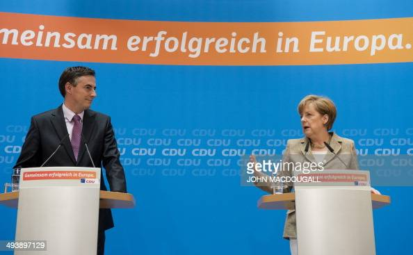 German Chancellor and leader of the Christian Democratic Union Angela Merkel and the CDU's main candidate David McAllister arrive for a press...