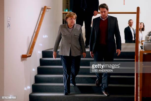 German Chancellor and leader of the Christian Democratic Union party Angela Merkel speaks with SecretaryGeneral of the Bavarian Christian Social...
