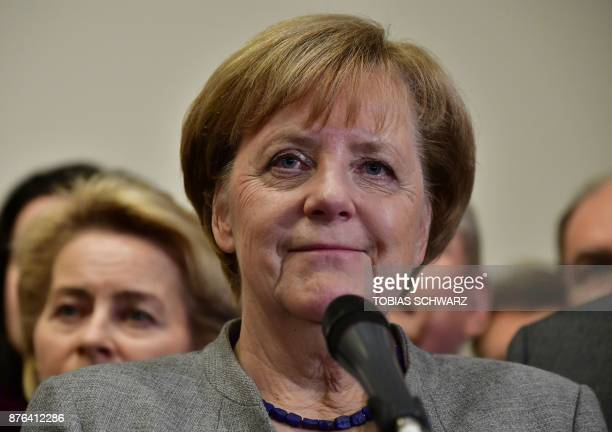 German Chancellor and leader of the Christian Democratic Union party Angela Merkel looks on while speaking after exploratory talks on forming a new...
