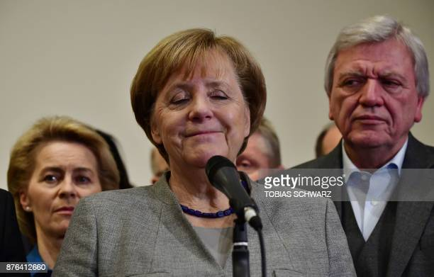 TOPSHOT German Chancellor and leader of the Christian Democratic Union party Angela Merkel closes her eyes while speaking after exploratory talks on...