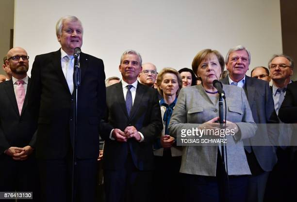 German Chancellor and leader of the Christian Democratic Union party Angela Merkel and CSU leader Horst Seehofer speak after exploratory talks on...