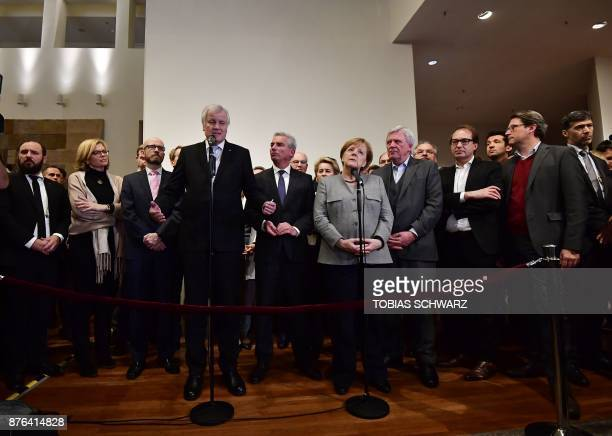 German Chancellor and leader of the Christian Democratic Union party Angela Merkel looks on Christian Social Union leader Horst Seehofer speaks after...