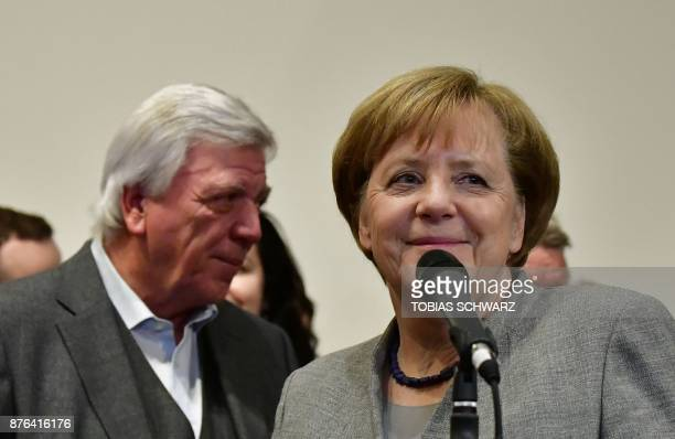 German Chancellor and leader of the Christian Democratic Union party Angela Merkel arrives to speak after exploratory talks on forming a new...
