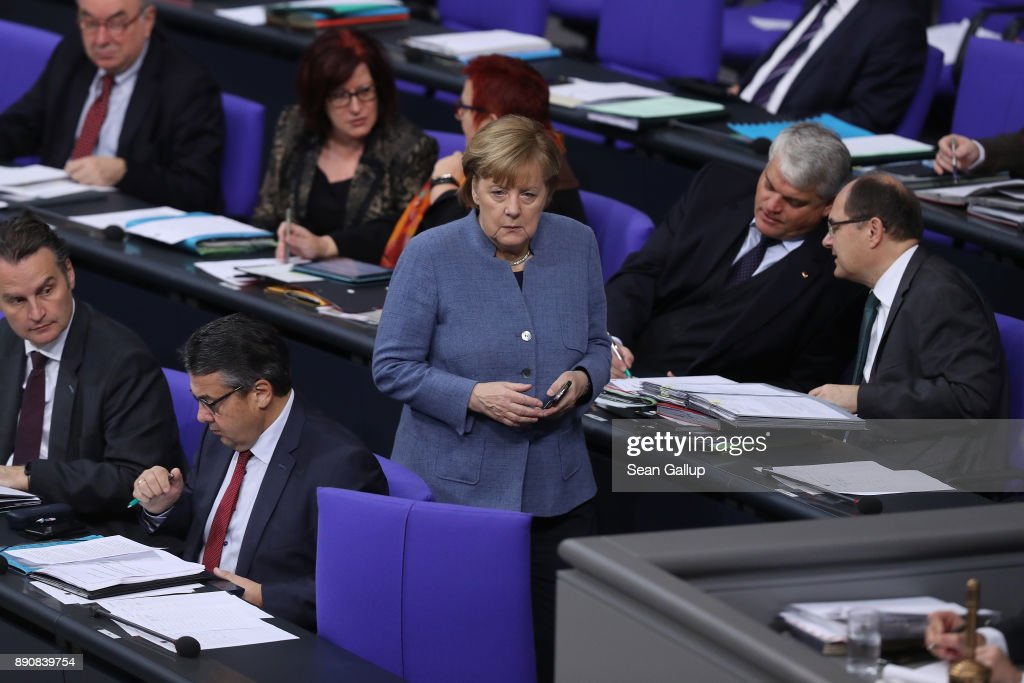 German Chancellor and leader of the German Christian Democarts (CDU) Angela Merkel (C) attends debates and votes at the Bundestag over German foreign military missions on December 12, 2017 in Berlin, Germany. Merkel met in private with Martin Schulz, head of the German Social Democrats (SPD), in a room at the Bundestag during the session. Leaders of the CDU, the SPD and the Bavarian Christian Democrats (CSU) are scheduled to meet tomorrow in initial talks over the creation of a government coalition between the three parties.