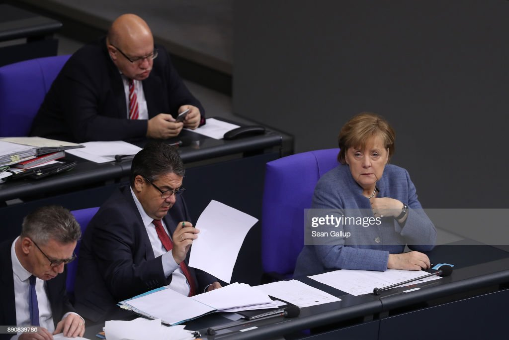 German Chancellor and leader of the German Christian Democarts (CDU) Angela Merkel (R) attends debates and votes at the Bundestag over German foreign military missions on December 12, 2017 in Berlin, Germany. Merkel met in private with Martin Schulz, head of the German Social Democrats (SPD), in a room at the Bundestag during the session. Leaders of the CDU, the SPD and the Bavarian Christian Democrats (CSU) are scheduled to meet tomorrow in initial talks over the creation of a government coalition between the three parties.