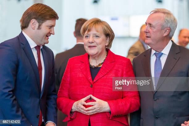 German Chancellor and leader of the German Christian Democrats Angela Merkel and Michael Broecker EditorinChief of the Rheinischer Post newspaper...