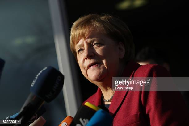 German Chancellor and leader of the German Christian Democrats Angela Merkel speaks to the media as she arrives for further talks the morning after...