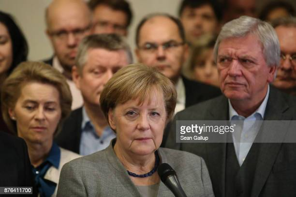 German Chancellor and leader of the German Christian Democrats Angela Merkel standing with leading members of her party speaks to the media in the...