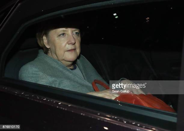 German Chancellor and leader of the German Christian Democrats Angela Merkel departs in the early morning after preliminary coalition talks collapsed...