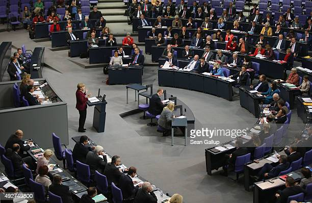 German Chancellor Angel Merkel gives a government declaration prior to debates at the Bundestag that centered on Germany's refugee policy on October...