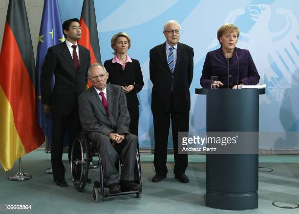 German Chancellor Angela Merkel accepts the 2010/2011 survey prepared by Germany�s Council of Experts for the Appraisal of Overall Economic...