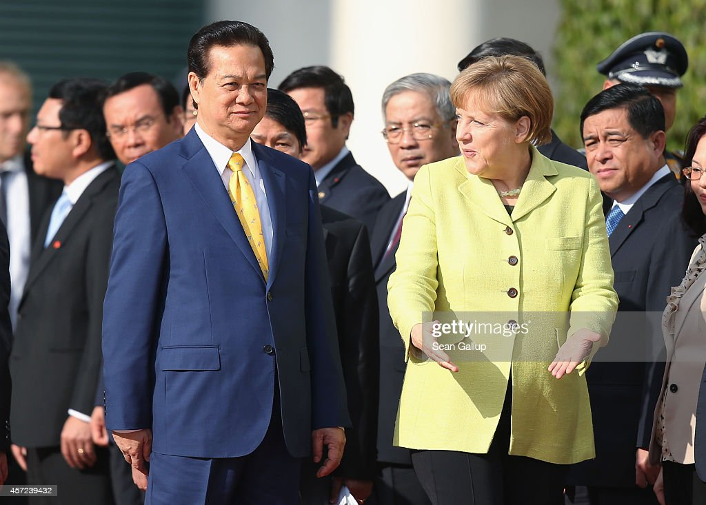 German Chancellor <a gi-track='captionPersonalityLinkClicked' href=/galleries/search?phrase=Angela+Merkel&family=editorial&specificpeople=202161 ng-click='$event.stopPropagation()'>Angela Merkel</a> accompanies Vietnamese Prime Minister <a gi-track='captionPersonalityLinkClicked' href=/galleries/search?phrase=Nguyen+Tan+Dung&family=editorial&specificpeople=544511 ng-click='$event.stopPropagation()'>Nguyen Tan Dung</a> upon his arrival for talks at the Chancellery on October 15, 2014 in Berlin, Germany. Prime Minister Nguyen is on a two-day visit to Germany that started yesterday with his arrival in Stuttgart.